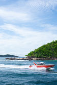The boat floats near to island — Stock Photo