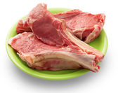 Beef on a green dish — Stock Photo