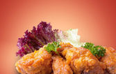 Fried bird in sour sweet sauce — Stock Photo