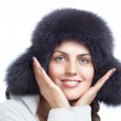 Winter girl with white fur hat wearing warm fur hat — Stock Photo #21046771