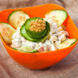 Salad in plastic bowl on fabric — Stock Photo #23528269
