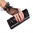 Woman hand in black lace gloves with purse, isolated on white — Stock Photo