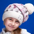 Portrait of an adorable baby girl wearing a knit pink and white winter hat. — Stock Photo