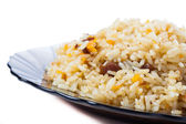 Caucasian traditional pilaf. Rice with meat. Isolation. — Stock Photo