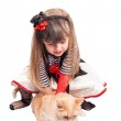 Little girl dressed as a pirate with a cat — Stock Photo