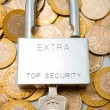 Pad lock on pile of coins — Stock Photo