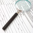 Magnifying glass and text  — Stock Photo