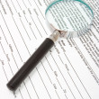 Magnifying glass and text — Stockfoto