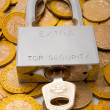 Stock Photo: Pad lock on pile of coins