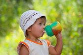 Girl and juice — Stock Photo