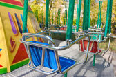 Carousel seat in park — Stock Photo