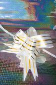White bow on shine background — Stock Photo