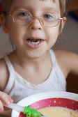 Girl having dinner — Stock Photo