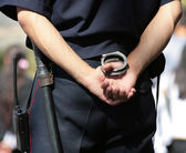 Policeman with handcuffs — Stock Photo