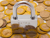 Pad lock on top of pile of coins — Stock Photo