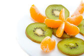Tangerune and kiwi — Stock Photo