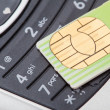 Cell phone and sim card — Stock Photo #38961459