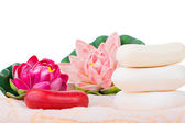 Towels, organic soap and lily — Stock Photo