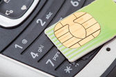 Cell phone and sim card — Stock Photo