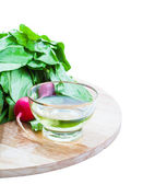 Radish, olive oil on wooden board — Stockfoto