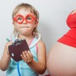 Little daughter with pregnant mother — Stock Photo #48514013