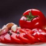 Red tomato slices — Stock Photo #48514165
