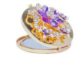 Makeup mini mirror with jewelry — Stock Photo