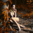 Glamorous lady in a tropical forest - Stock Photo