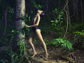 Glamorous lady in a tropical forest — Stock Photo