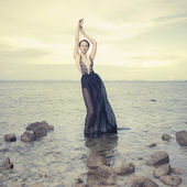 Glamorous lady standing in sea — Stock Photo