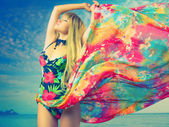 Luxurious blonde in color dress — Stock Photo