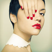 Lady with bright nail polish — Photo