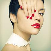 Lady with bright nail polish — Stock Photo