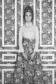 Elegant lady on floral background — Stock Photo
