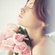 Charming lady with roses — Stock Photo