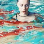 Beautiful woman in the pool — Stock Photo