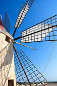 Windmill top with shadows and blue sky — Stock Photo