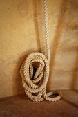 Windmill rope tied up at a wall, Italy — Stock Photo
