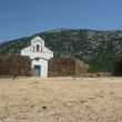 Stock Photo: SPietro church on Golgo upland with stone wall