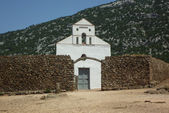 San Pietro church with stone wall close-up — Stock Photo