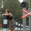 Stock Photo: Girl near railroad