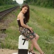 Pretty girl near railroad — Stock Photo