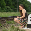 Pretty girl near railroad — Stock Photo #12246326