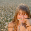 Stock Photo: Girl with fun wheat moustache on face