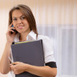 Young woman speak by phone with financial papers in hands — Stock Photo