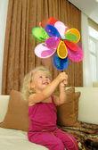 Baby girl with pinwheel — Stock Photo
