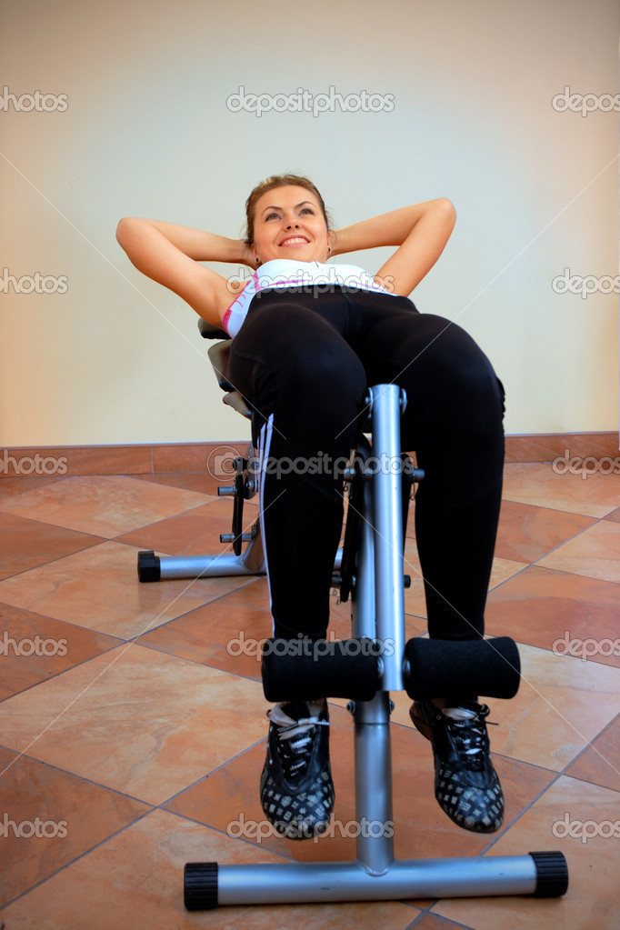 Young women in the fitness center making exercise — Stock Photo #12247615