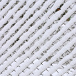 Braided fence under snow — Stock Photo