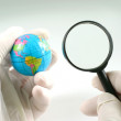 Earth globe & human hand — Stock Photo