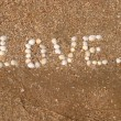 Love inscriptions on the beach — Stock Photo